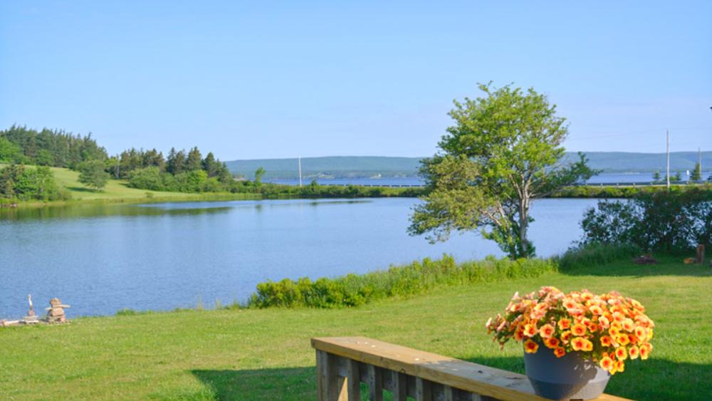 Weltreise im Camper Weg auf Zeit Aussicht von ihrem Haus in Cape Breton